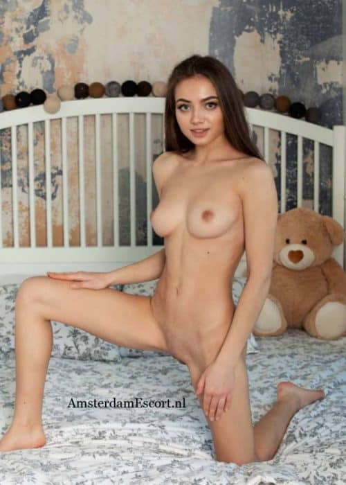 Angelina Kneeling on One Leg in Bed Fully Nude.