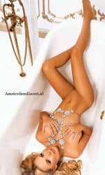 Arina Laying in Tub Fully Nude with Jewelry Around Neck and Stomach.