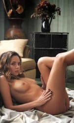 Bianca Fully Nude Sitting on Floor Against Couch with Legs Up.
