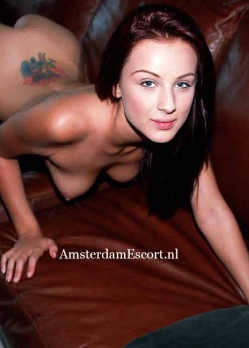Clara kneeling On Couch Fully Nude.