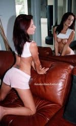 Clara kneeling On Couch Topless In Front Of Mirror.