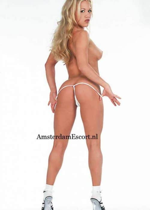 Dee Standing Topless Pulling Down White Panties.