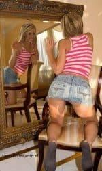 Endora kneeling On Chair Looking In Mirror.