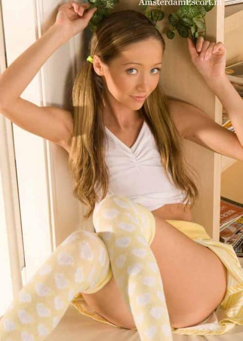 Felicia Sitting In Yellow Skirt And White Top.