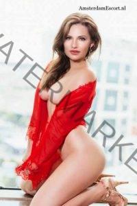 Helena Kneeling in Red Wrap on Her Side.