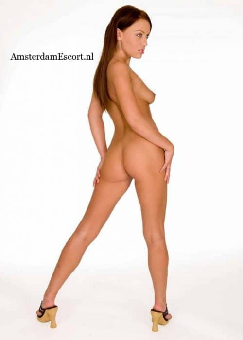 Holly Standing Fully Nude With Hands At Her Side.