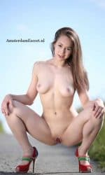 Jody Kneeling Fully Nude Outside with Legs Spread.