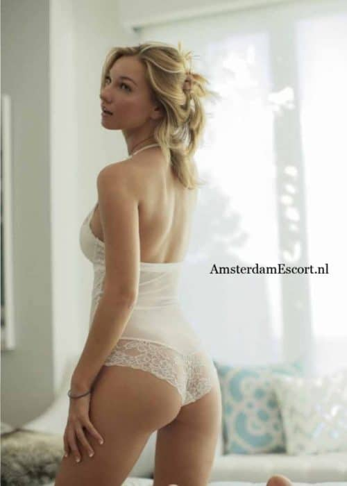 Leyla Kneeling in White Lingerie Showing Butt with Hands at Side.