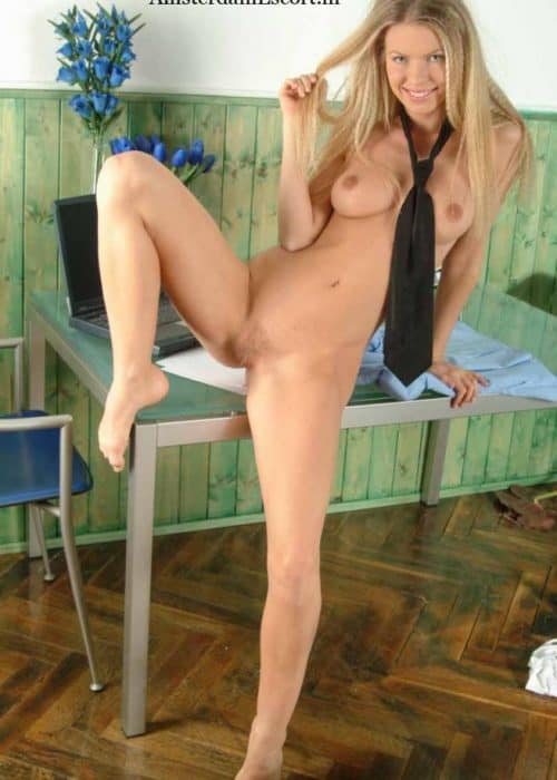 Marketa Sitting on Table Fully Nude with Legs Spread Wearing a Tie.