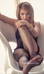 Melody Sitting Fully Nude with Hands Up in The Air Fishnet Stockings.