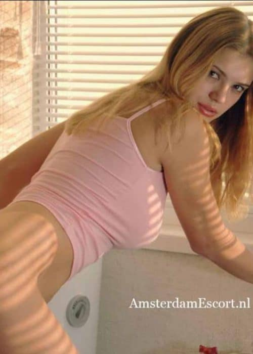 Milena Bending Over Bottomless Showing Bare Butt in White Shirt.
