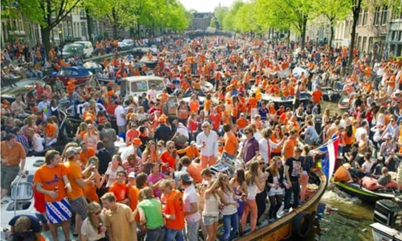 Kings Day Party at Canals in Amsterdam