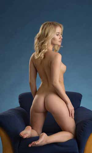 Avery kneeling fully nude with butt out.